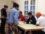 Volunteers registering families