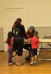 Volunteers registering families
